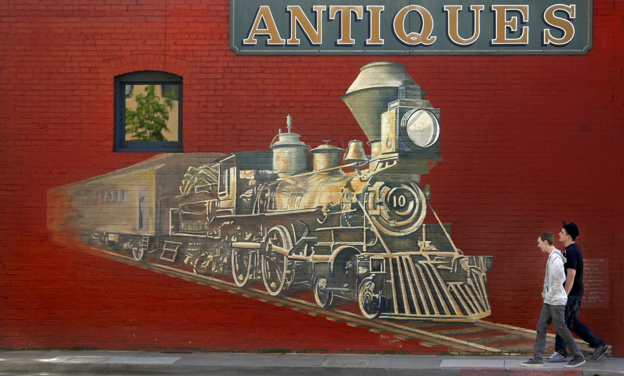 A mural of a steam engine on the side of Whistlestop Antiques serves as the defacto entrance to the Historic Railroad Square district in Santa Rosa. (Kent Porter / The Press Democrat)