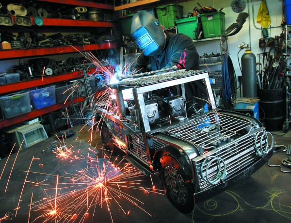 4/1/2012: T4:  PC: Metal artist James Selby welds a new light bar on top of his tow truck in his Santa Rosa studio.