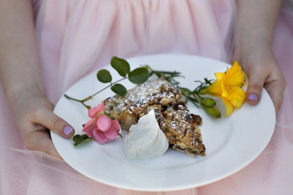 Fiona Grimm, 7, holds an apple cranberry crostata with a cinnamon topping and creme anglaise during a spring brunch class at Ramekins on Sunday, April 17, 2016 in Sonoma, California . (BETH SCHLANKER/ The Press Democrat)