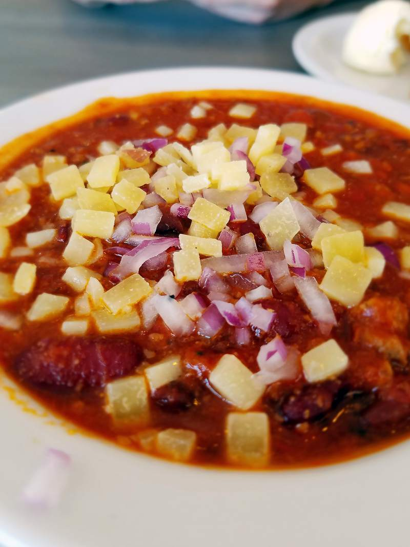 Homemade chili with cheese and onions at Fiori's Grill in Santa Rosa. (Heather Irwin / The Press Democrat)