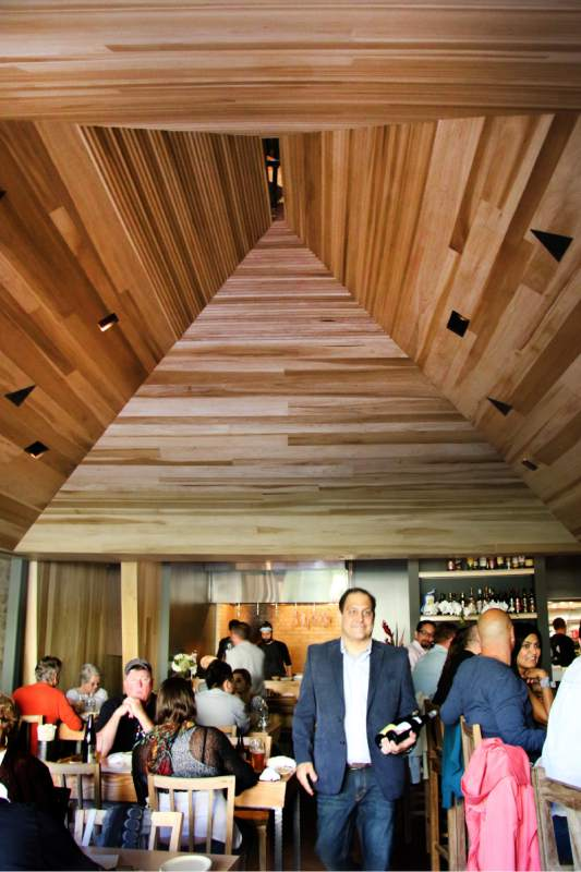The interior of Miminashi restauarnt in Napa was built to mimic the lines of a Buddhist temple, with low ceilings for a cozy environment. (Heather Irwin / The Press Democrat)