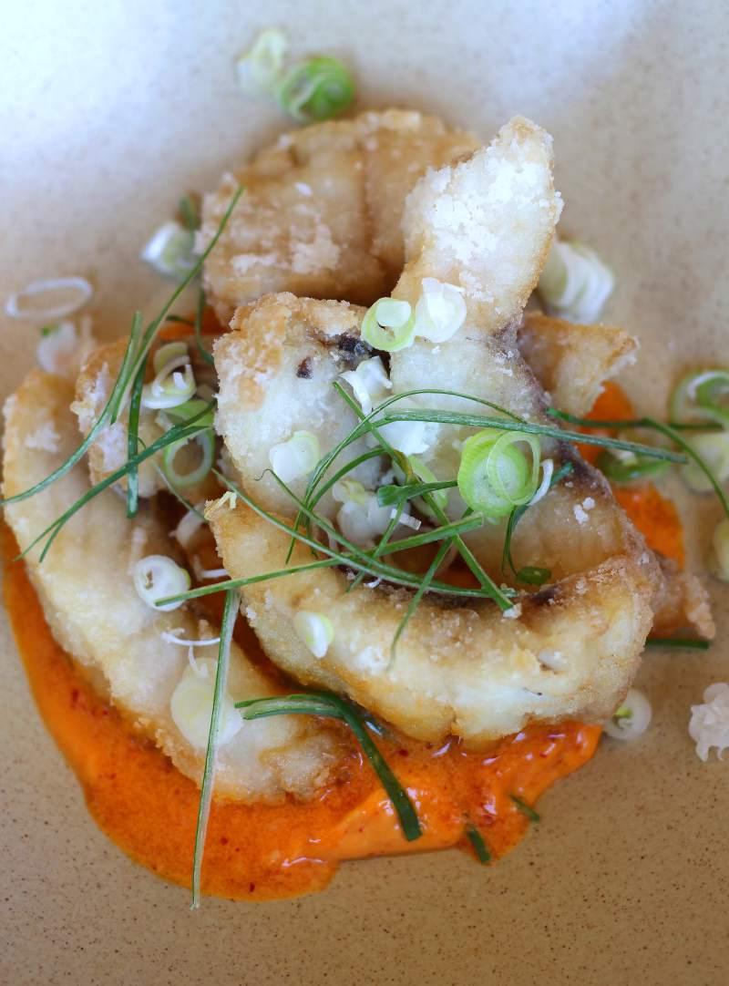 Rock cod karaage with chili, garlic, creme fraiche, Toyko negi at Miminashi restaurant in Napa. (Heather Irwin / The Press Democrat)