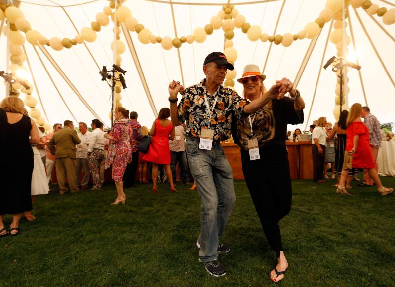 Eugene and Harriet Becker of Long Island, New York, dance to live music during Auction Napa Valley, 2016. (Alvin Jornada / The Press Democrat)