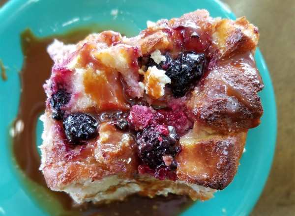 Donut bread pudding with fresh berries and caramel at Zephyr Chocolates pop up at the East Wind Bakery in Santa Rosa. (Heather Irwin / The Press Democrat)