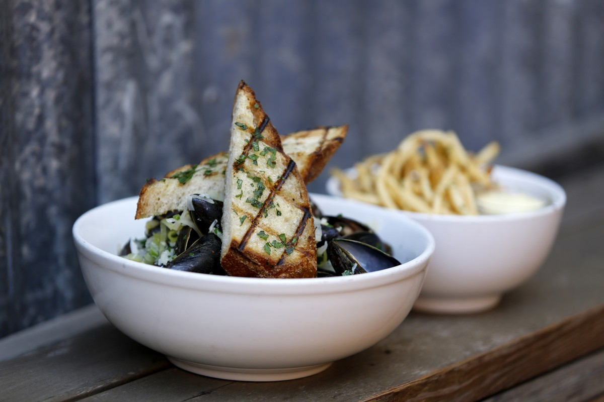 Pastis-scented steamed mussels and fries at The Girl & the Fig in Sonoma. (Beth Schlanker / The Press Democrat)