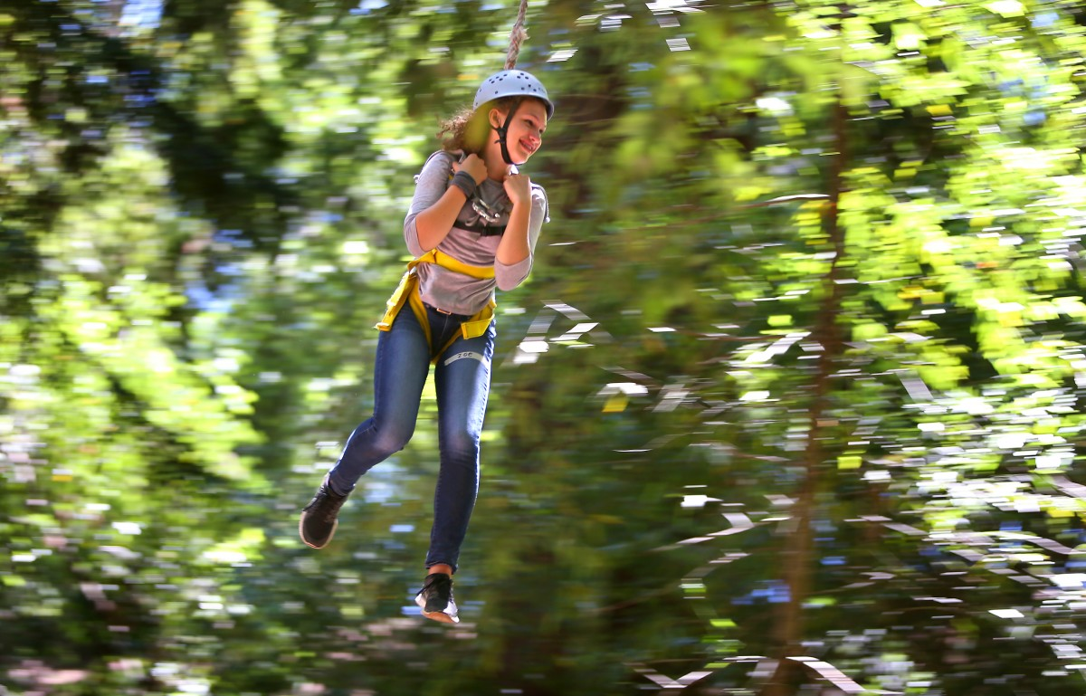 Zoe Ingram rides a zipline through the redwoods at Challenge Sonoma Adventures Ropes Course in Glen Ellen. (Photo by Christopher Chung)