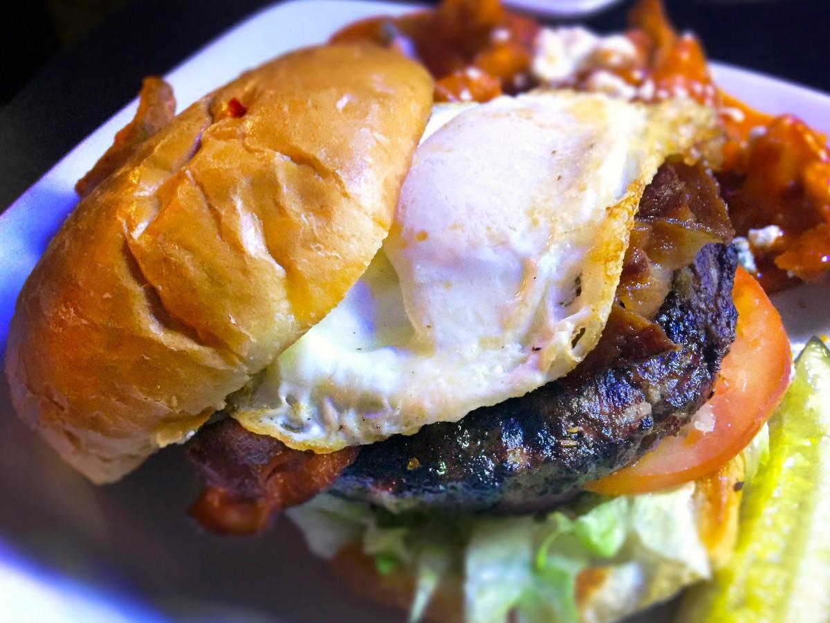 Pork Belly Burger at Hey Misster in Santa Rosa on 4/16. (Heather Irwin / The Press Democrat)