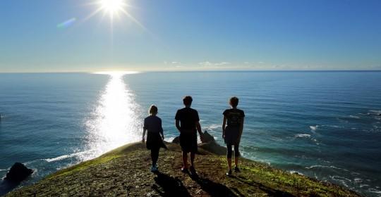 Friends enjoy a hike on the bluffs above Goat Rock beach in Jenner on Thursday. (JOHN BURGESS / The Press Democrat)