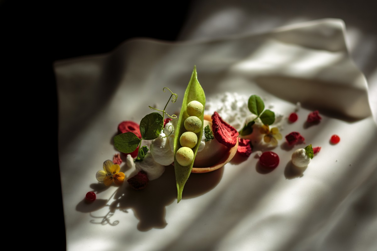 """Manny Fimbrez's """"Peas and a Pod"""": a strawberry tart with a pulled-sugar pea pod filled with lemon ganache """"peas"""" rolled in pea powder."""