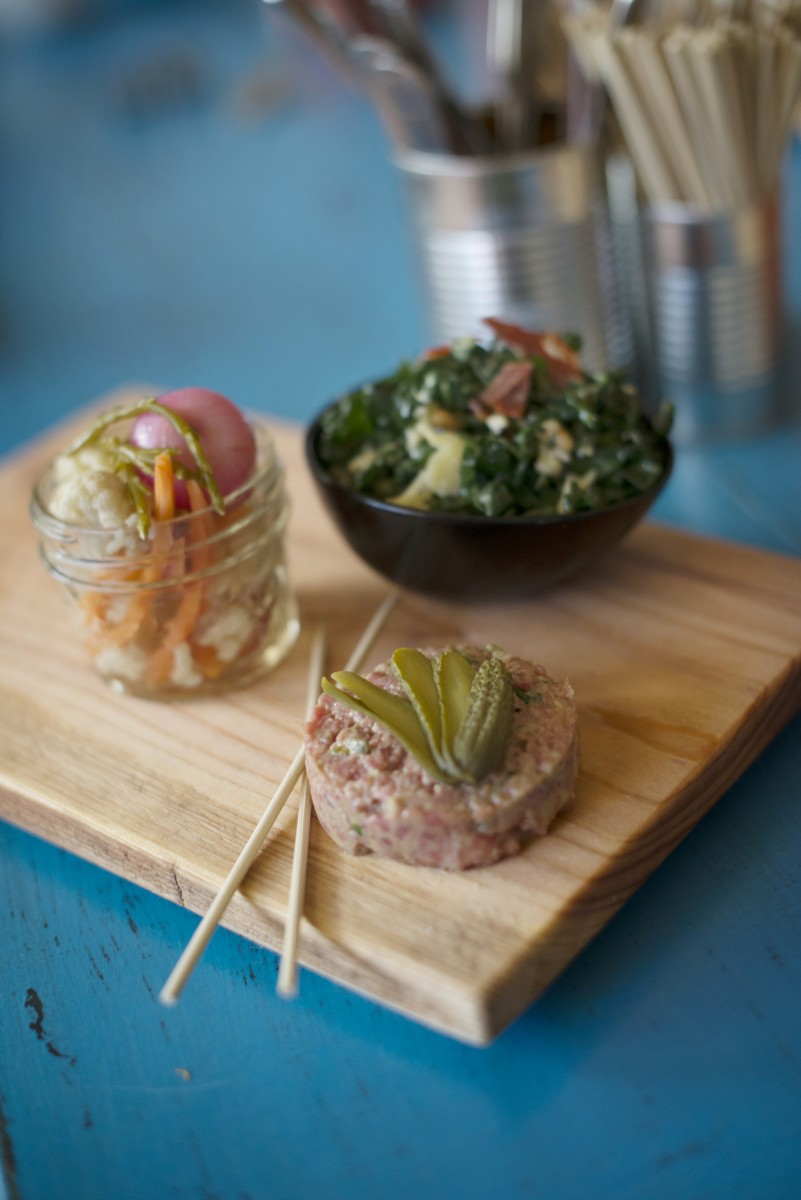 Steak tartare with marinated vegetables, left and a kale salad in an anchovy dressing at Tasca Tasca.