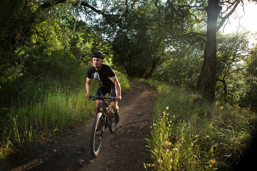 Toraj Soltani, owner of Mac's Deli, rides Marsh Trail in Annadel State Park Friday Evening. (Photo by Charlie Gesell for the Press Democrat)