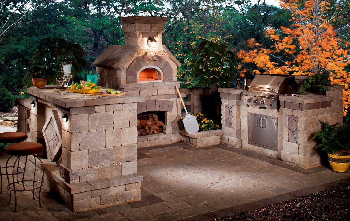 5 gorgeous outdoor rooms to enhance your backyard for Outdoor stone kitchen designs