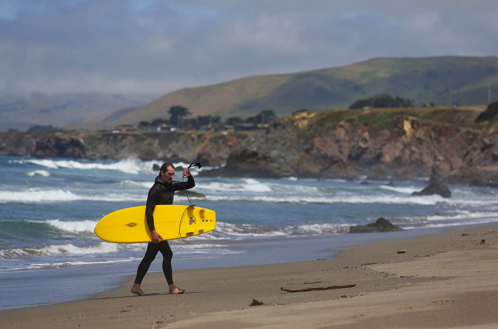 Bill Blaze, of Sebastopol, walks up the beach after surfing at Salmon Creek Beach. (Photo by Christopher Chung)