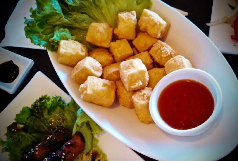 The crispy fried tofu at Simmer is served with a sweet and spicy chili sauce.