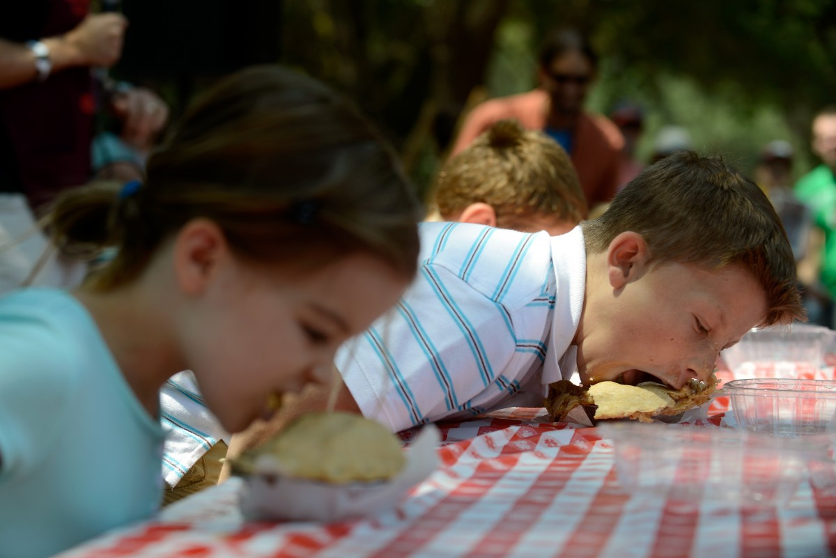 John Simmons, age 12, right, and his sister Katherine, age 8, compete in the second round of the apple pie eating contest at the Gravenstein Apple Fair in Sebastopol, California, on August 8, 2015. Gravenstein Apple Fair