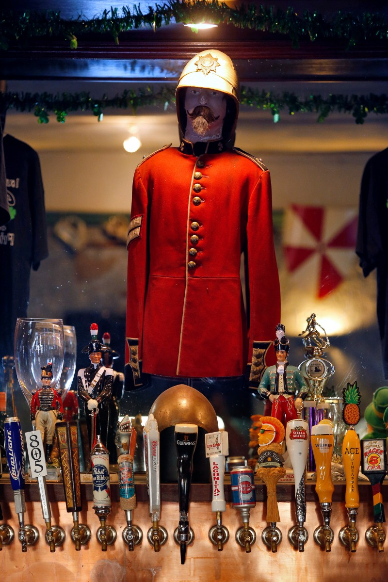 An Irish Guards uniform tunic and other Irish-themed decorations stand above the beer tap during a football game between the Miami Dolphins and Atlanta Falcons at Friar Tucks Pub in Cotati, California on Thursday, August 25, 2016. (Alvin Jornada / The Press Democrat)