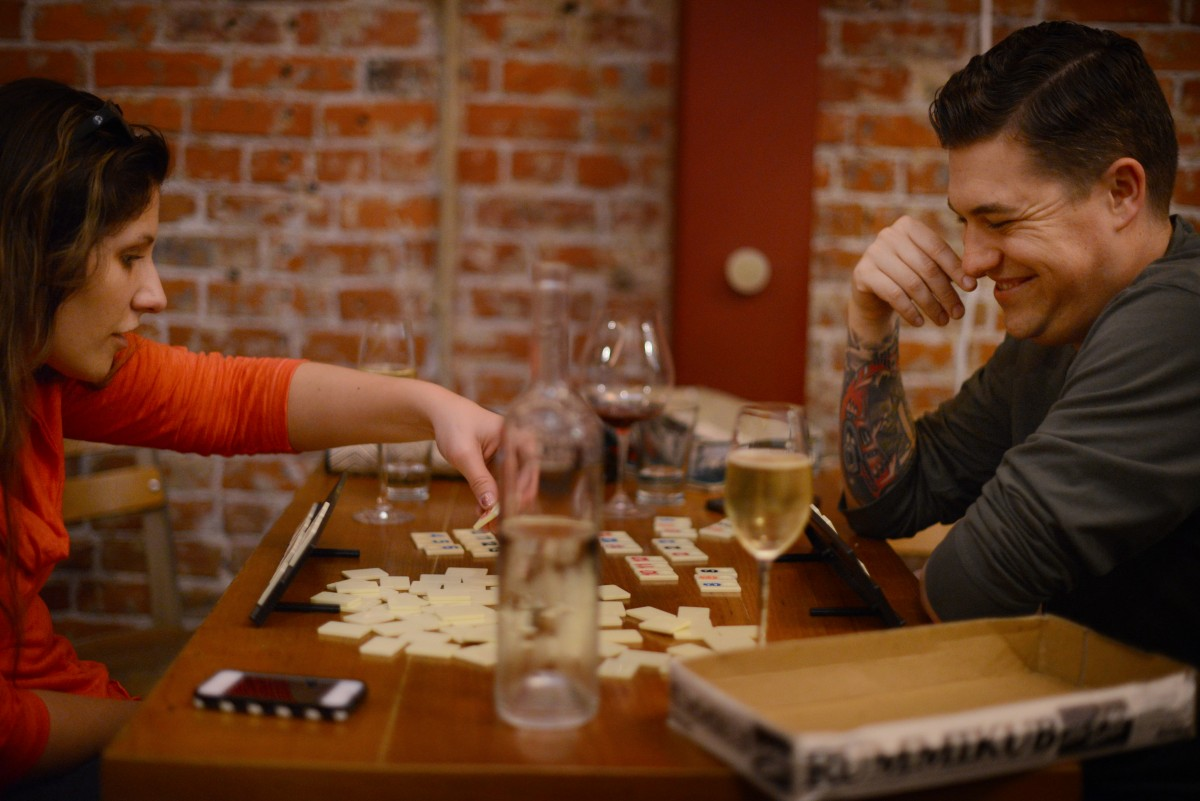 Christina and Mike Velzo, both from Chicago, playing Rummikub, one of the many games available at Bergamot Alley Bar & Wine Merchants in Healdsburg. February 24, 2014. (Photo: Erik Castro/for The Press Democrat)