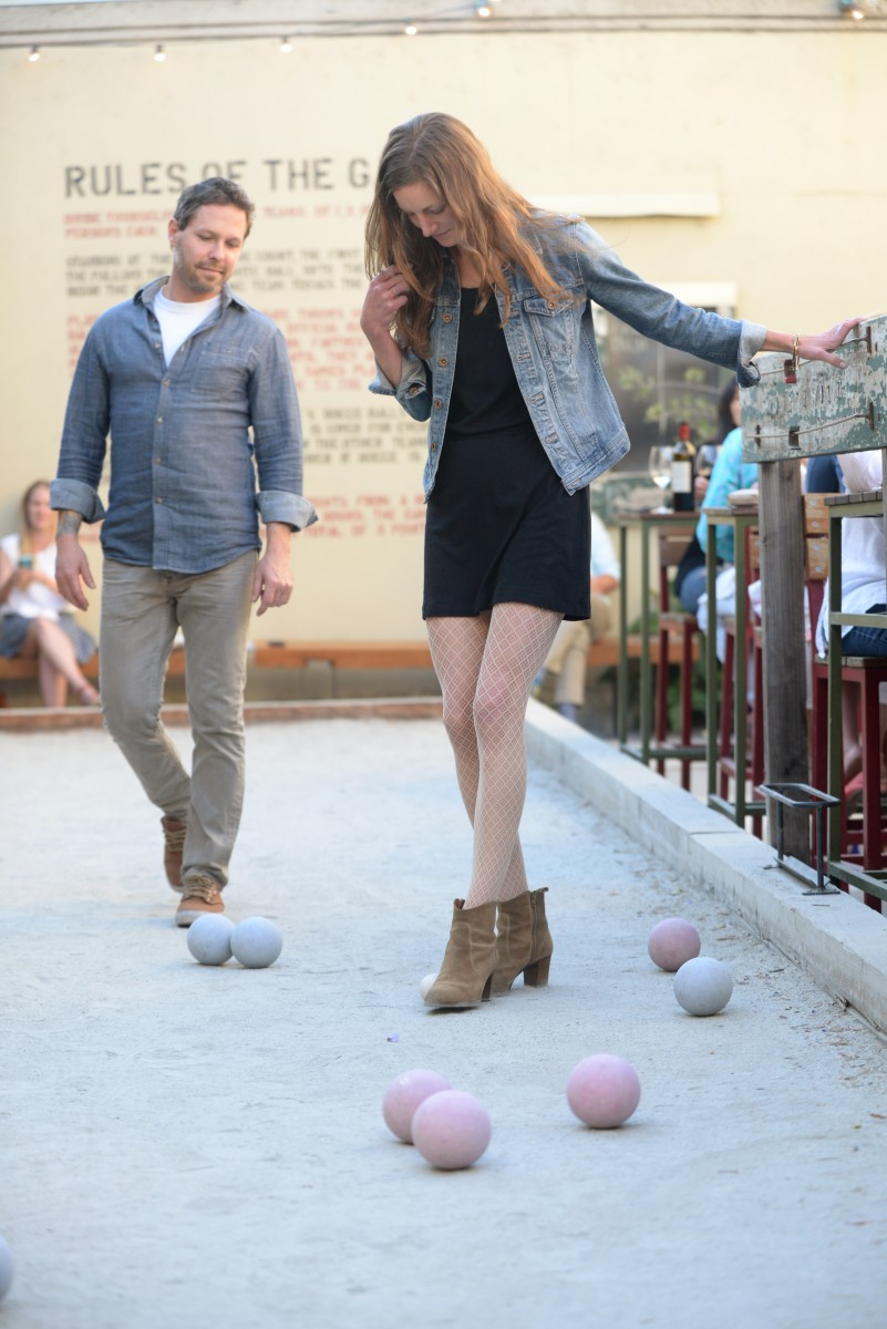 Scott and Jenny Schultz playing bocce ball during dinner service at Campo Fina restaurant in Healdsburg. May 9, 2015. (Photo: Erik Castro/for The Press Democrat) Erik Castro