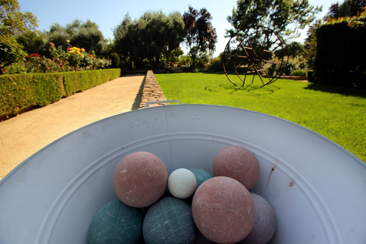 A bocce ball court and lawn sculpture at The Mulberry House garden in Sonoma. (Photo by Christopher Chung)