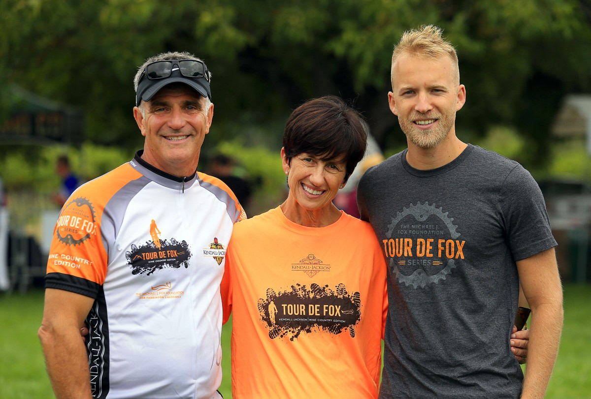 Left to right, Rick Tigner, CEO of Jackson Family Wines, Wendy Tigner and Sam Fox with the Michael J. Fox Foundation at the after party for the Tour de Fox Wine Country Edition at the Kendall-Jackson Winery in Santa Rosa. (JOHN BURGESS/The Press Democrat)