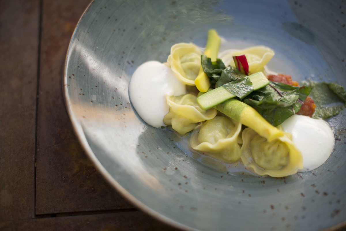 Tortellini filled with braised rabbit and served with heirloom tomatoes, pesto and parmesan foam at Rancho Nicasio Bar and Restaurant in Nicasio, California, August 13, 2016. (Photo: Erik Castro/for The Press Democrat)