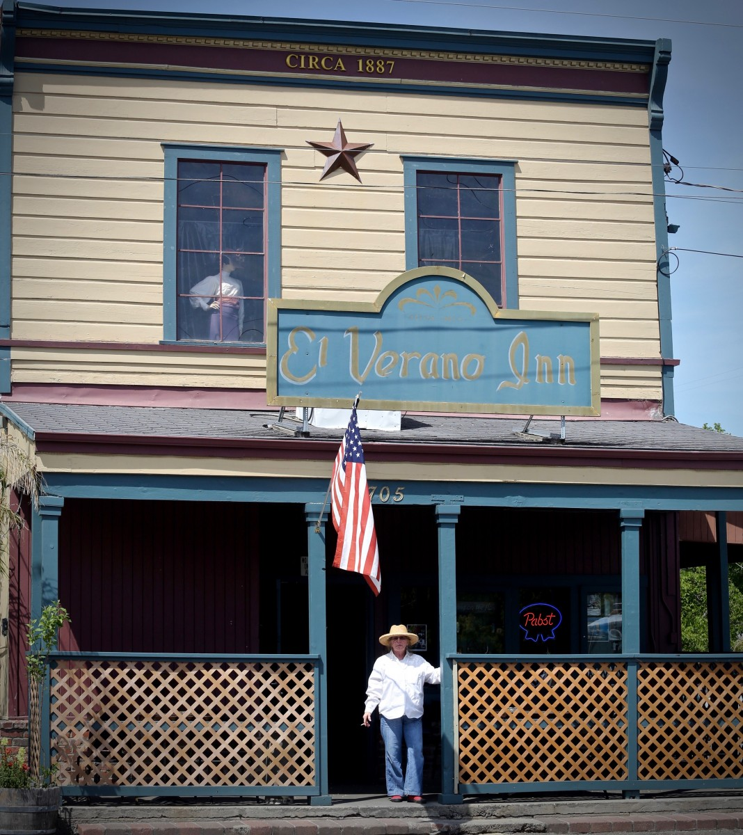 Phyllis Thiebaut, long time patron of El Verano Inn, stands on the front of Sonoma stands on the patio of Sonoma's El Verano Inn Friday, April 18, 2014. Thiebaut has been a patron of the El Verano Inn for the last 30 years. (Crista Jeremiason / The Press Democrat)