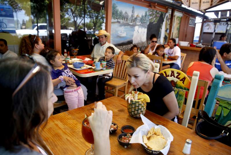 Natasha Wawiluk sips on a Pina Chavela made with beer, Clamato and spices during lunch with her mother at Mi Terra Mexican Restaurant in Santa Rosa.