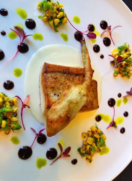 Sautéed White Sea Bass with Crisp Zucchini Flower, Sweet Corn Purée and Corn-Shishito Chutney at Dry Creek Kitchen. Heather Irwin/PD