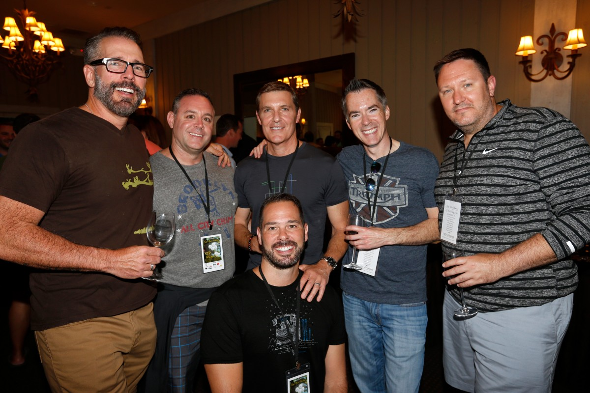 Out in the Vineyard co-host Mark Vogler, left, with friends from Orlando, Floriday (left to right): Vince Koehle, Richard Egan, Bruce Jennings, Wes Wagaman, and Steve Yacovelli (kneeling) during the Gay Wine Weekend welcome reception at MacArthur Place in Sonoma
