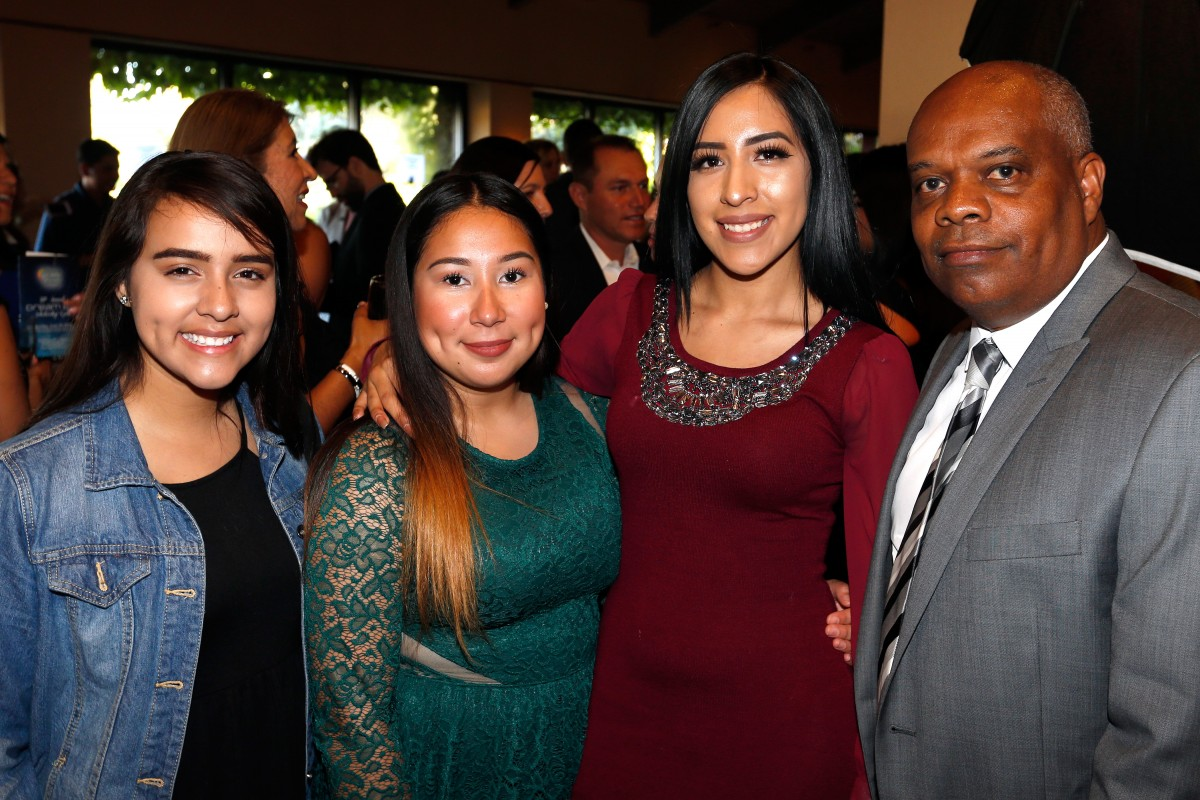Piner High School students Fatima Aguilar and Andrea Romero, with SRJC student Itzel Martinez and Vince Harper of Community Action Partnership attend the Hispanic Chamber of Commerce Sonoma County's Dream Big Gala in Rohnert Park.