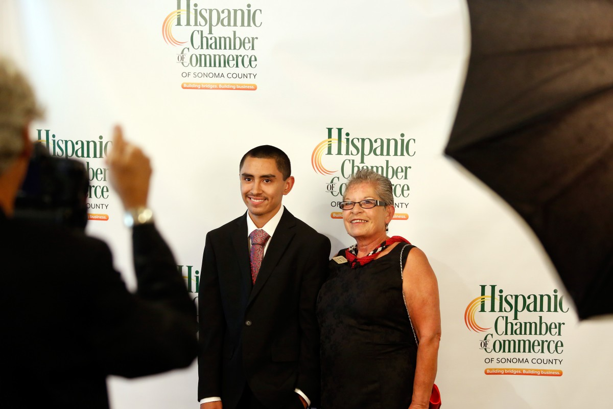 Donna Zapata, right, and her nephew Eric Maldonado have their photo taken during the Hispanic Chamber of Commerce Sonoma County's Dream Big scholarship gala in Rohnert Park.