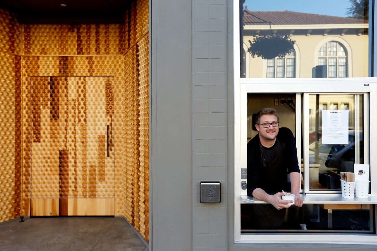 Executive chef/owner Curtis Di Fede stands inside the walk-up ice cream window beside the unique wood front door at Miminashi, a Japanese izakaya, in Napa, California on Tuesday, August 30, 2016. (Alvin Jornada