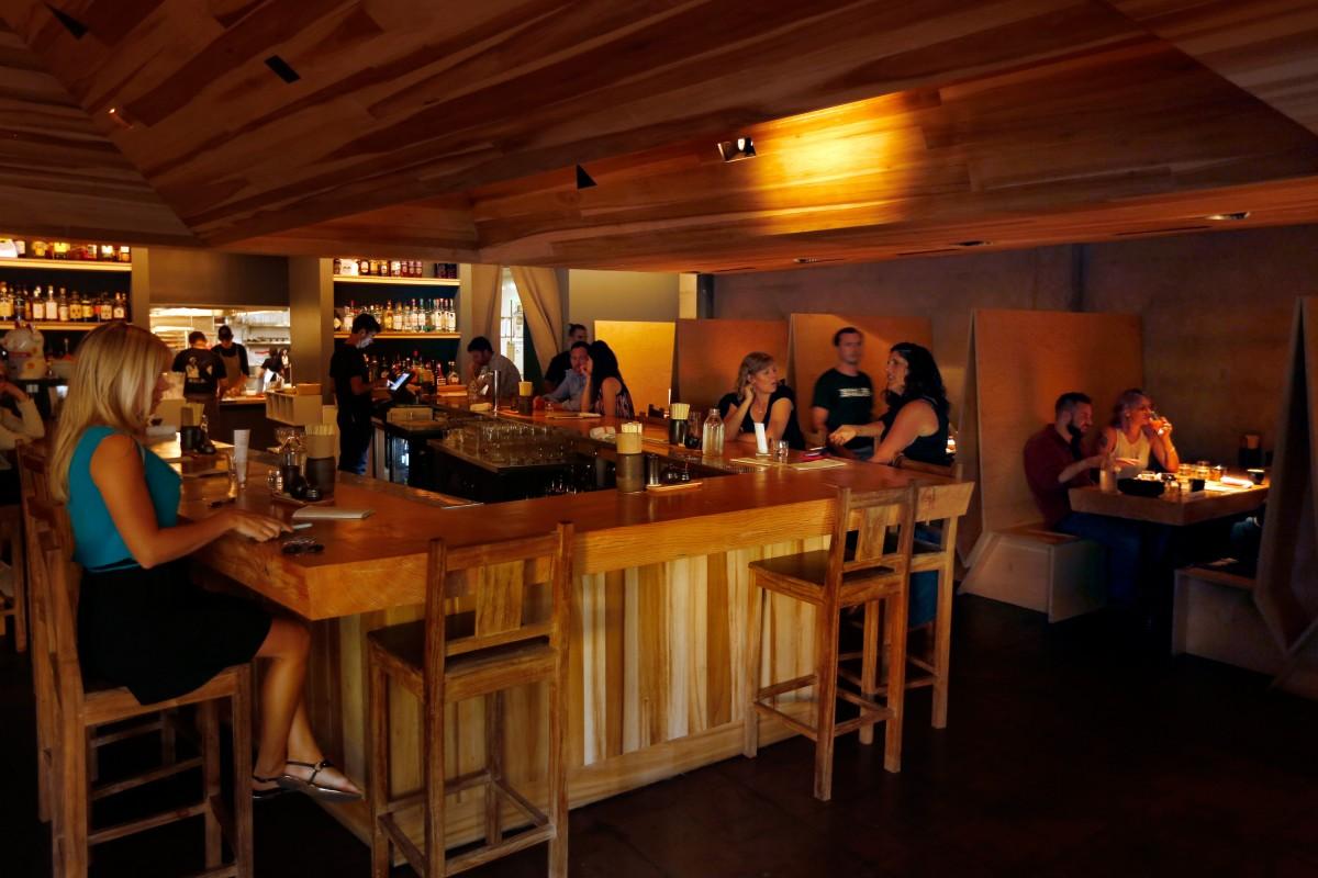 Customers enjoy dinner and drinks at Miminashi, a Japanese izakaya, in Napa, California on Tuesday, August 30, 2016. (Alvin Jornada