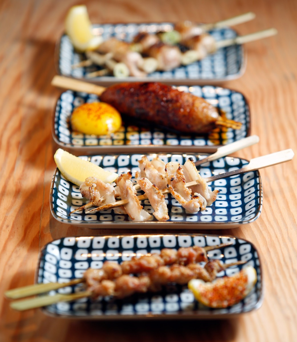 A selection of robatayaki / yakitori, from front to rear: kawa (chicken skin), yagen nonkotsu (chicken cartilage), Tsukune (chicken meatball) with egg yolk, and momoshiniku (boneless chicken thigh) with negi (Welsh onion), at Miminashi, a Japanese izakaya, in Napa, California on Tuesday, August 30, 2016. (Alvin Jornada / The Press Democrat)