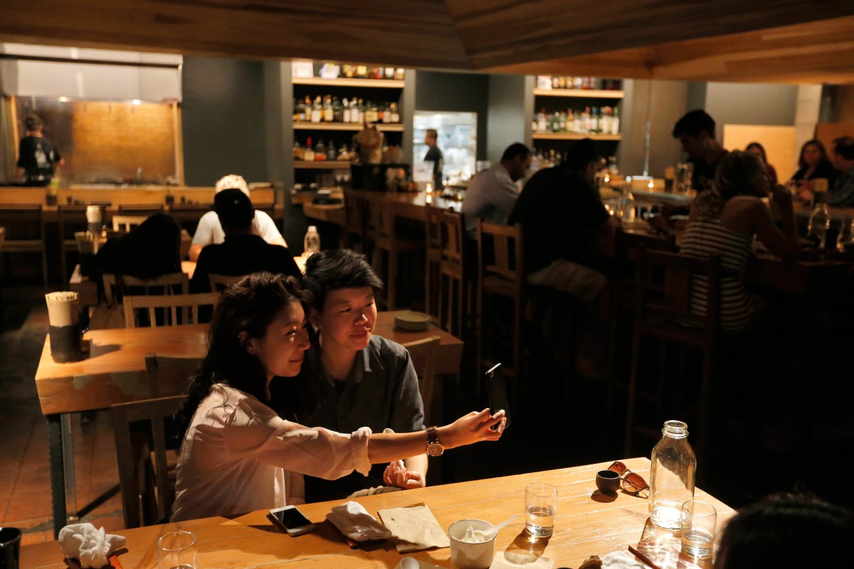 Lorraine Tiang, left, snaps a selfie with Wan Chan after their dinner at Miminashi, a Japanese izakaya, in Napa, California on Tuesday, August 30, 2016. (Alvin Jornada / The Press Democrat) Miminashi