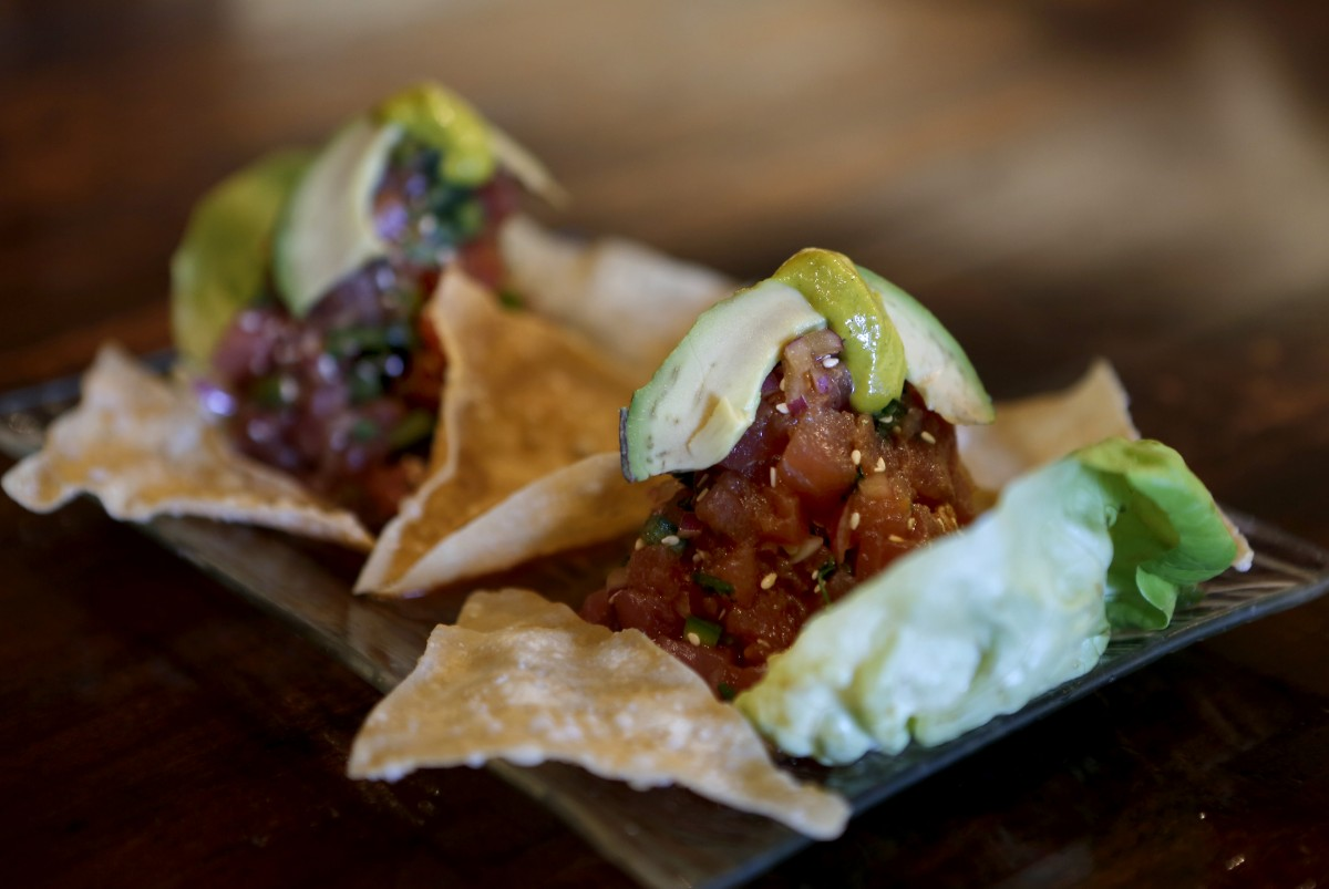 The Ahi Ceviche Nikei, is a dish of raw ahi tuna mixed with soy and ponzu sauces, onions, jalapeno, cilantro, chilies, sesame seeds, and avocado at Sazon, a Peruvian restaurant, in Santa Rosa, California on Tuesday, April 30, 2013. (BETH SCHLANKER/ The Press Democrat)