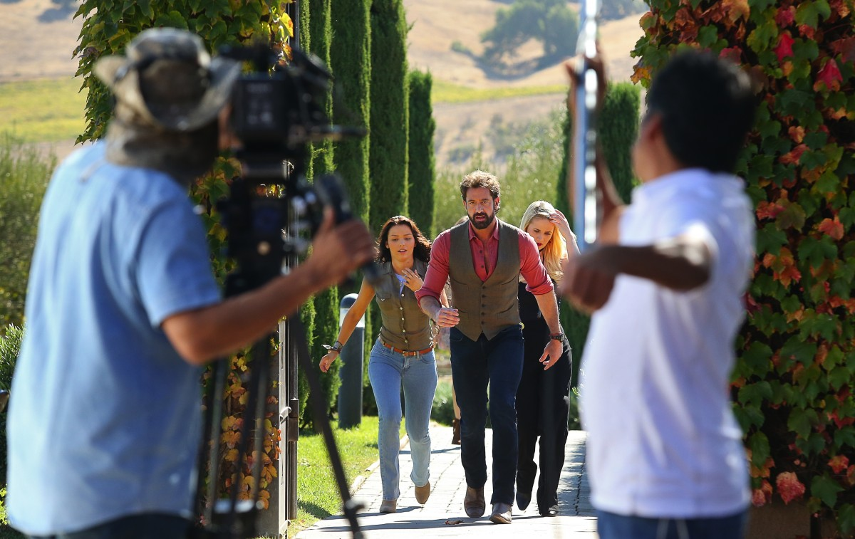 Actors Gabriel Soto, center, Irina Baeva, left, and Kimberly Dos Ramos, march into a scene, as they film the telenovela Vino El Amor, at Viansa Sonoma winery, near Sonoma, on Thursday, September 29, 2016. The show is set to air on October 24, on Univision. (Christopher Chung/ The Press Democrat)