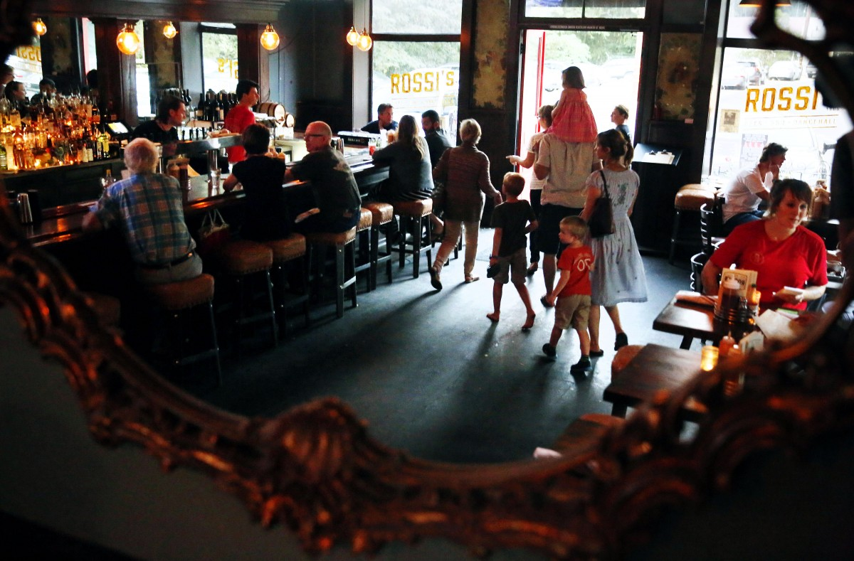 Families come and go from Rossi's or the newly revived Little Switzerland in El Verano on Friday, August 22, 2014. (Conner Jay/The Press Democrat)