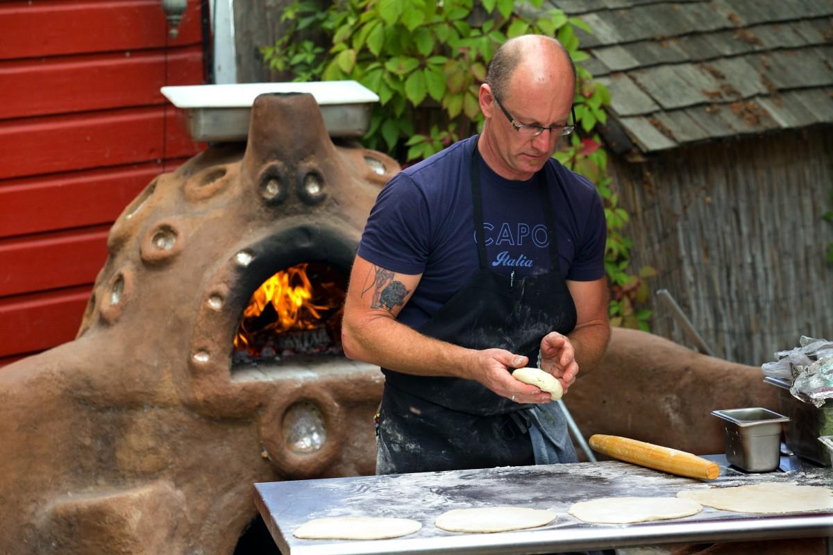 Sebastian Chevrolet makes pizza in the wood fired oven at the Fork Roadhouse on Bodega Ave. east of Sebastopol. (JOHN BURGESS/The Press Democrat)