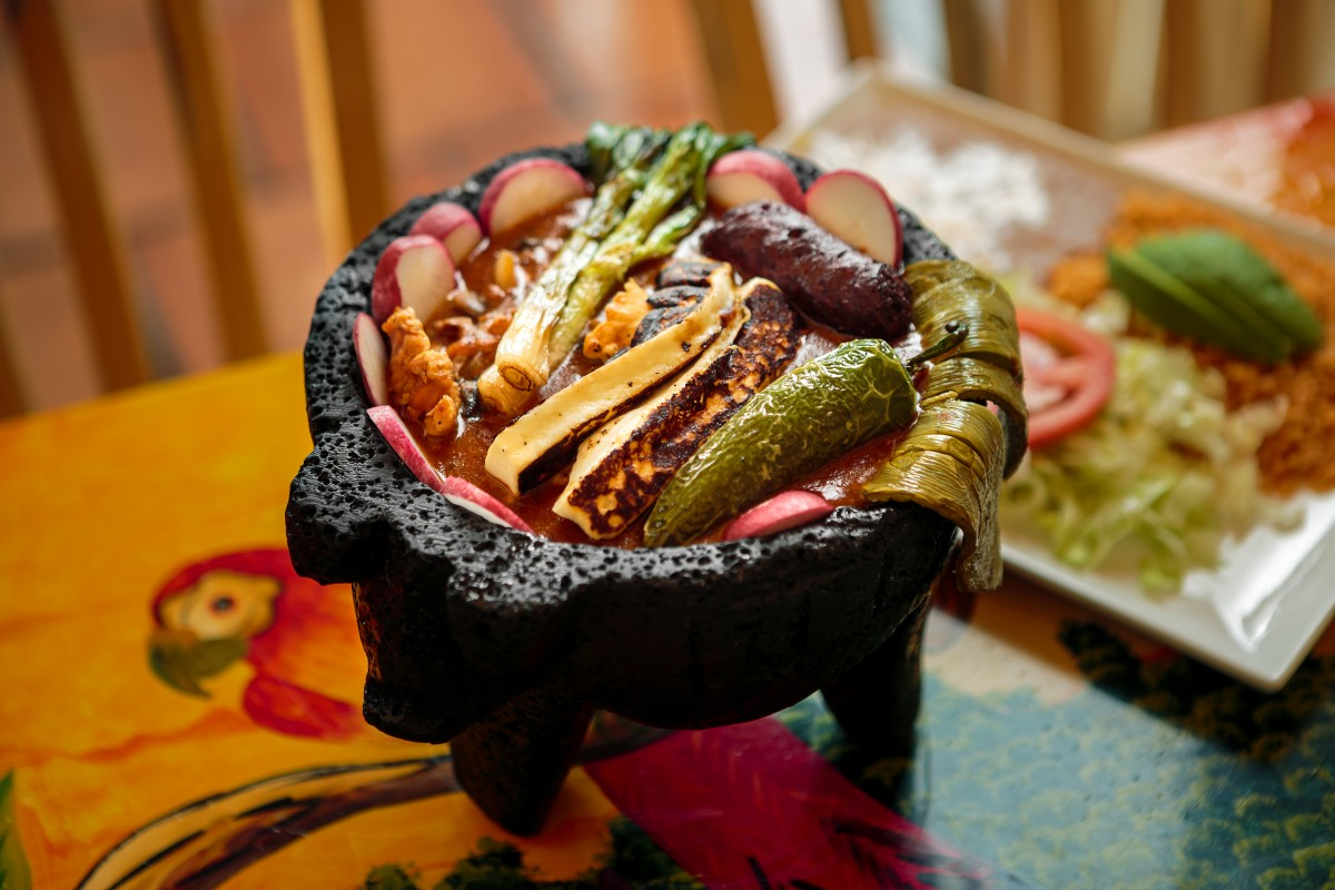 Molcajete dish of steak, prawns, chicken, mushrooms, grilled cactus, roasted chiles, a huge slab of queso fresco, onion, tomato and spicy broth all served in a stone molcajete bowl from Mi Tierra in Santa Rosa Food shots for Cheap Eats section Chris Hardy