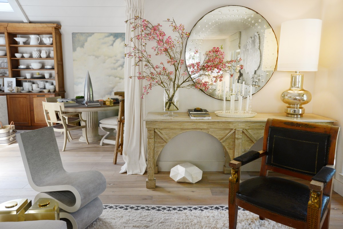 The living room and part of the kitchen area at the Healdsburg home of interior designer Benjamin Dhong. April