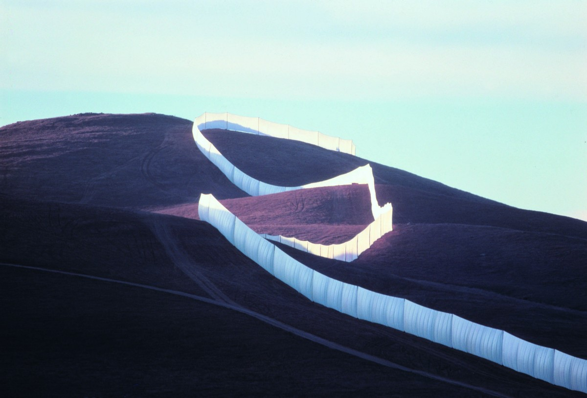 The Running Fence follows the contours of the land as it rises to cross a ridge. Photo must be credited to Wolfgang Volz, copyright Christo 1976. From a large-format color transparency lent by Christo and Jeanne-Claude.