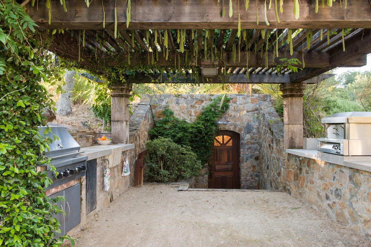 Outdor kitchen and wine cellar entry.