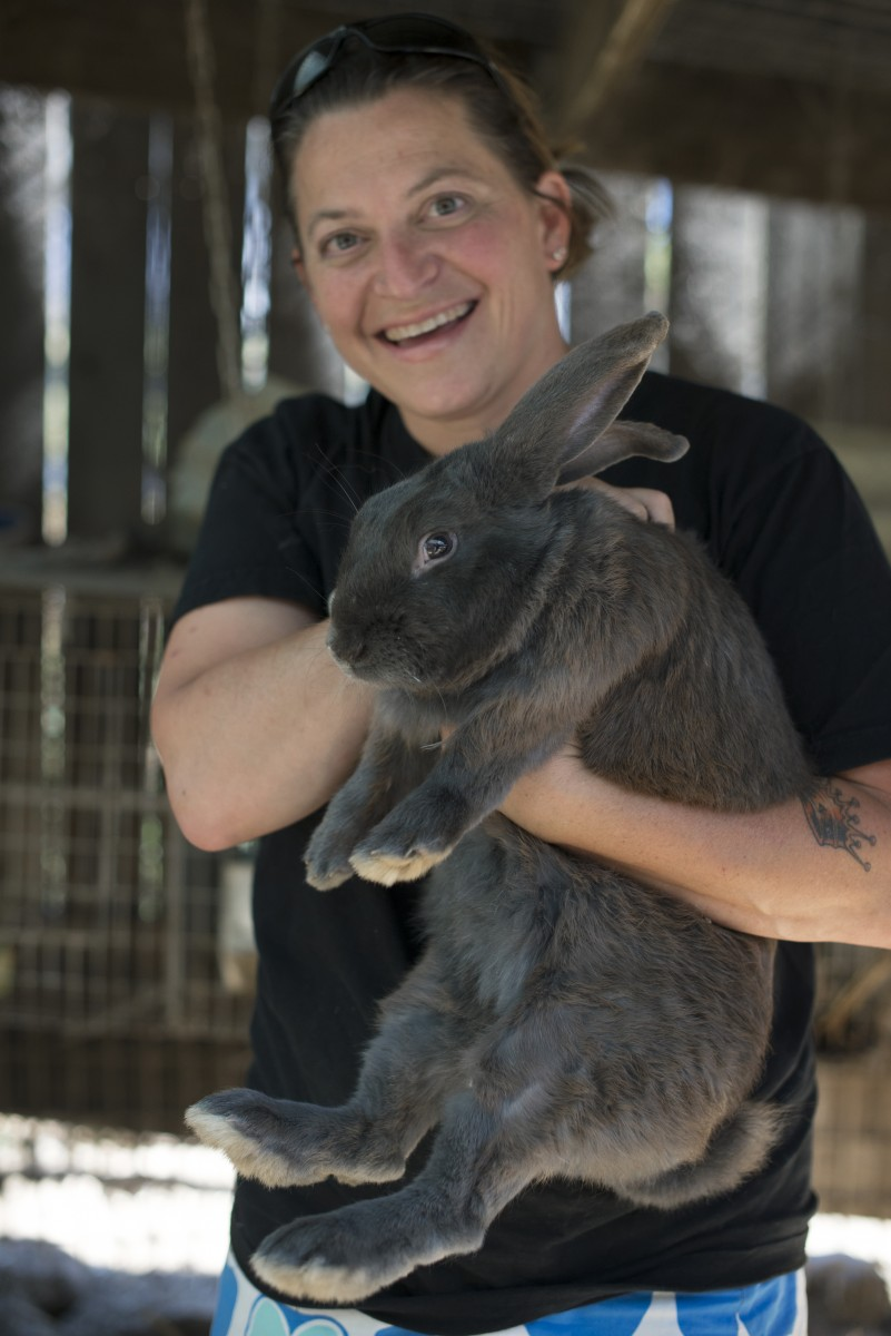 Duskie Estes with one of her rabbits at her home in Forestville, California. June 18, 2016. (Photo by Erik Castro)