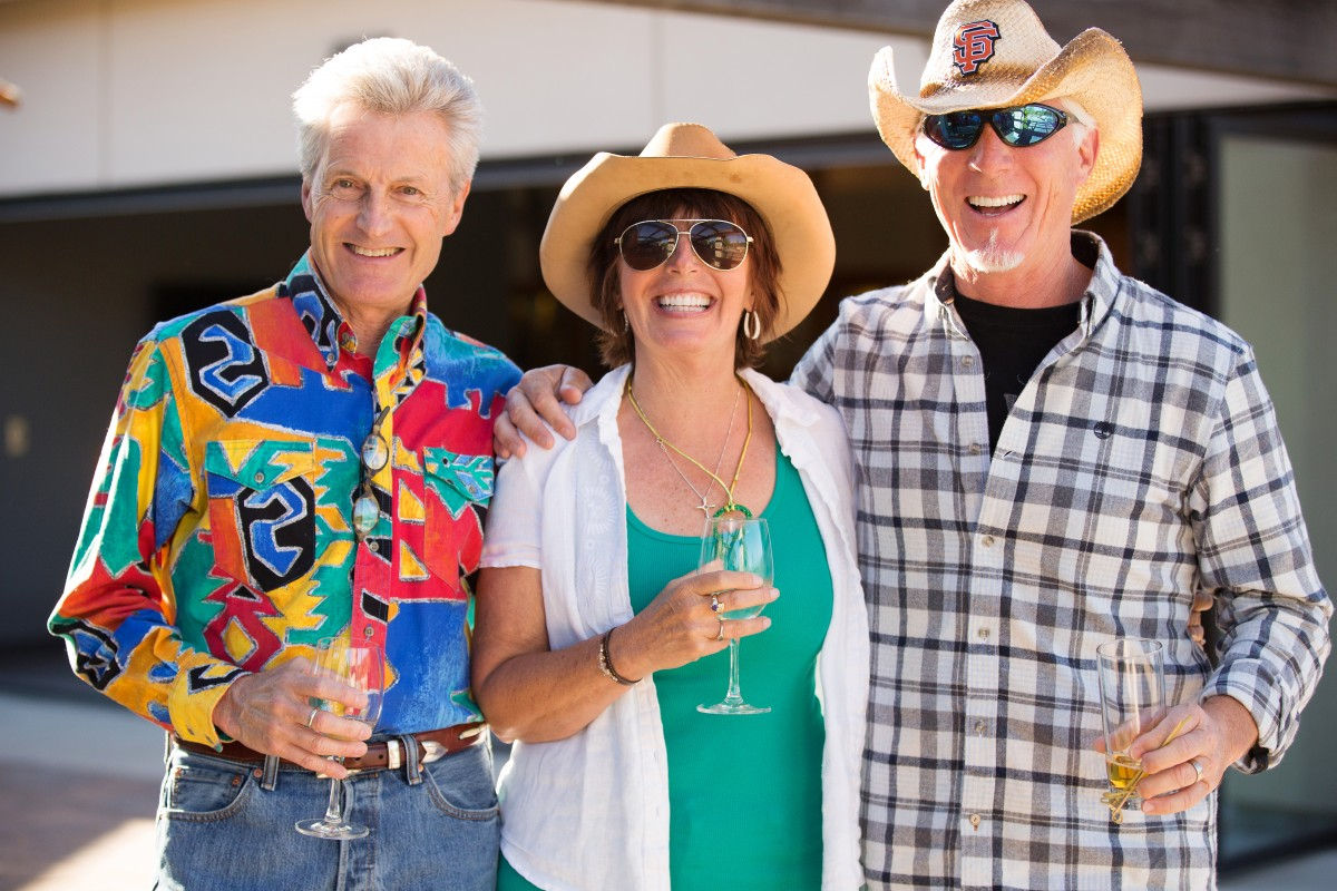 John Coulson of Sonoma, left, with Brooke and Chris Davis of Rohnert Park at the Hanna Boys Center barbecue, a fundraiser for the residental school's agriculture rogram
