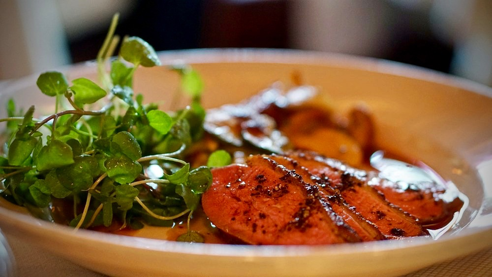 Sonoma County duck breast au poivre with Lucero Farms squash gratin, roasted cèpes, and watercress
