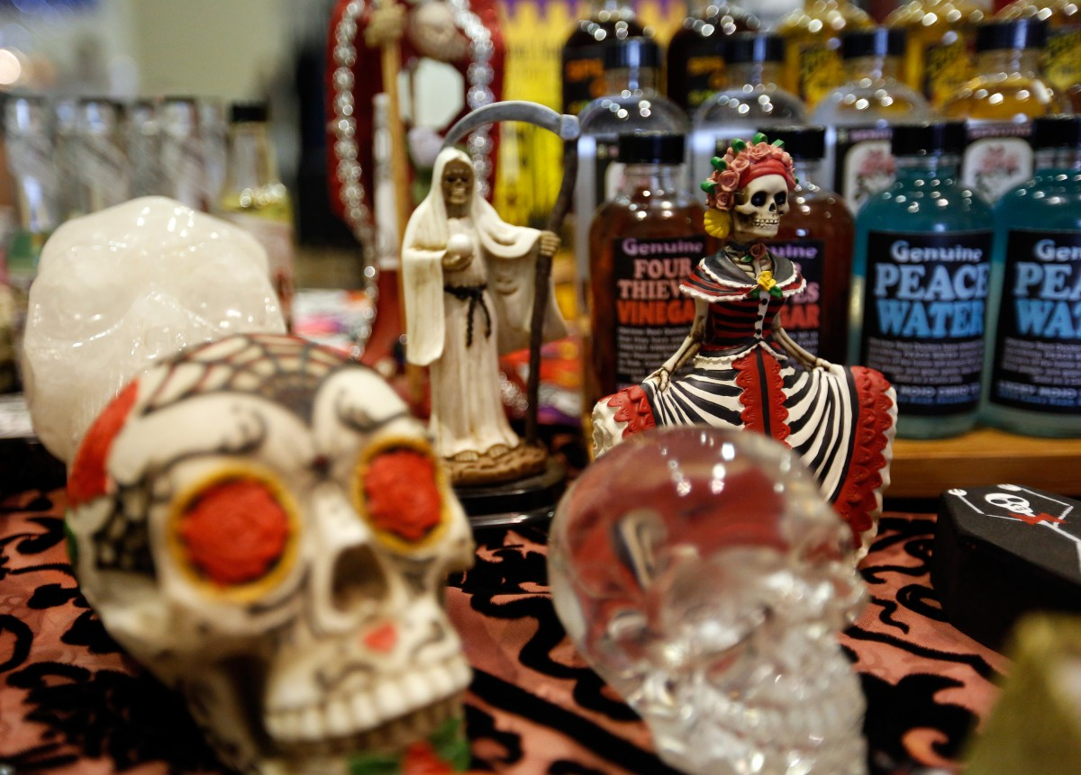 A variety of Day of the Dead figurines and other products on display at the Lucky Mojo Curio Co. booth during the Mystic Fair in Santa Rosa, California on Sunday, October 18, 2015. (Alvin Jornada / The Press Democrat) Alvin Jornada