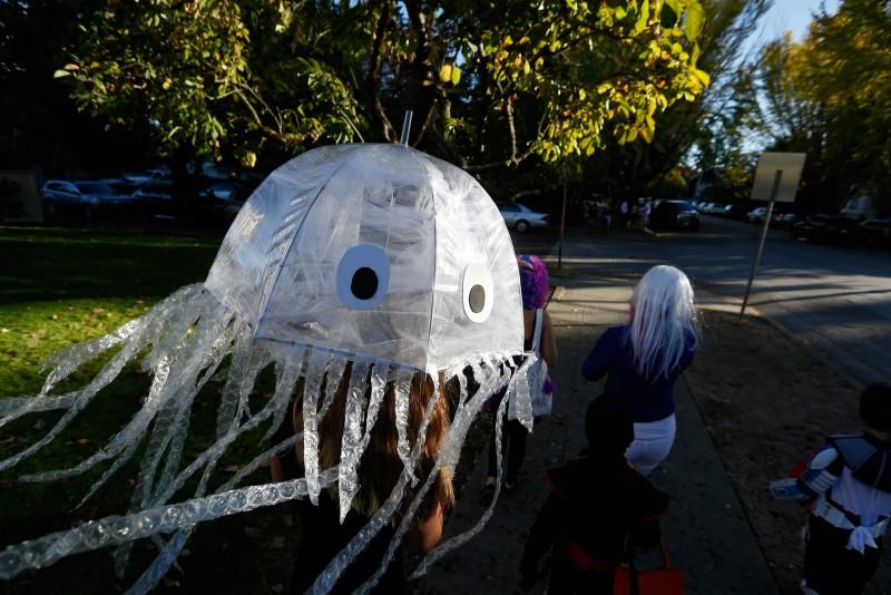 Gianna Ratto, 11, in her homemade jellyfish costume floats down McDonald Avenue during Halloween in Santa Rosa, California on Saturday, October 31, 2015. (Alvin Jornada / The Press Democrat)