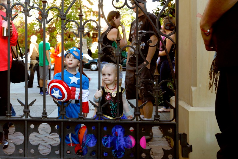 Jonathan Pascale, 4, and his sister Aurora, 2, wait for the McDonald Mansion gates to open during Halloween on McDonald Avenue in Santa Rosa, California on Saturday, October 31, 2015. (Alvin Jornada / The Press Democrat)