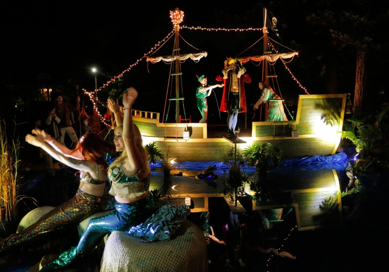 Mermaids cheer as Peter Pan makes Captain Hook walk the plank during Halloween at the McDonald Mansion in Santa Rosa. (Photo by Alvin Jornada)